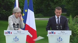 Emmanuel Macron laughs off Theresa May