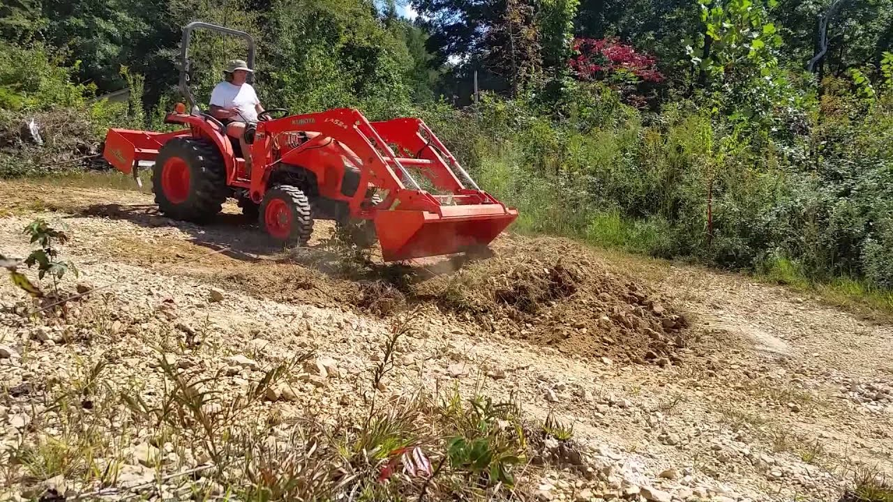 Tractor with Box Blade Grading a Driveway