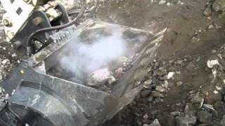 ECO-CRUSHER has the LARGEST CRUSHER BUCKET in the WORLD - Rotary Crushing Concrete.wmv