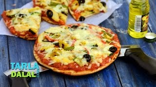 Cheesy Zucchini And Baby Corn Pizza By Tarla Dalal