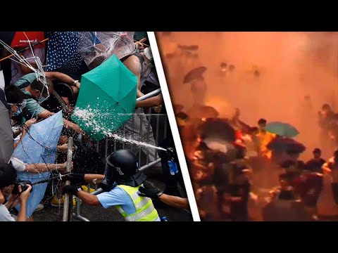 Hong Kong Protesters Fight Police Attacks With Umbrellas