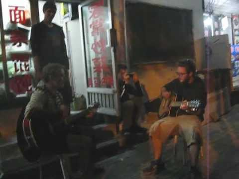 Playing Czech song in streets of Qingdao in China