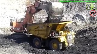 Hitachi EX2500 Excavator Loading Komatsu HD785 Dump Truck