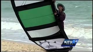 Beach goer fined for helping beginner kite-surfer