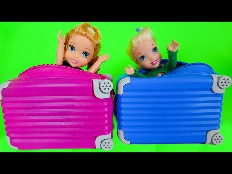 Elsa and Anna toddlers buy suitcases to go on holidays