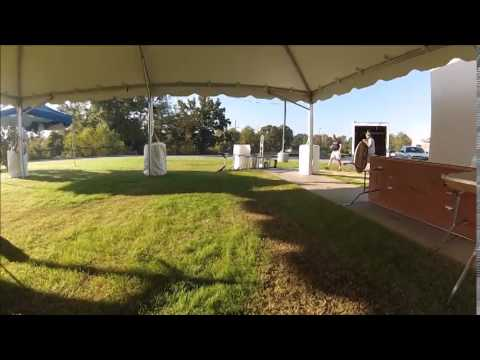 drone flight one - Event Rentals take down of (2) 30x60 Frame Tents