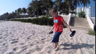 Little Boy Goes Barefoot on the Sandy Beach