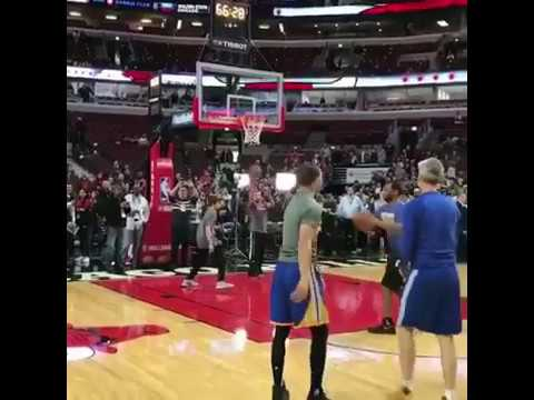 Stephen Curry works with Golden State Warriors Assistant Coach Bruce Fraser pregame in Chicago