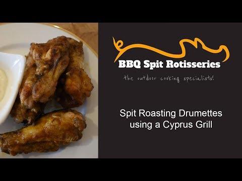 Cooking Chicken Drumettes On Spit Rotisserie Basket
