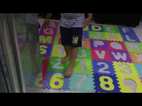 ABC Puzzle Mats: Jayden playing with his rubber mat