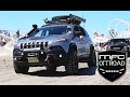 Modified Jeep Cherokee KL Takes on a Beach Obstacle Course