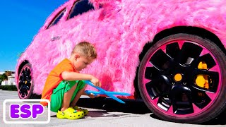 Vlad y Niki juegan y montan en autos de juguete