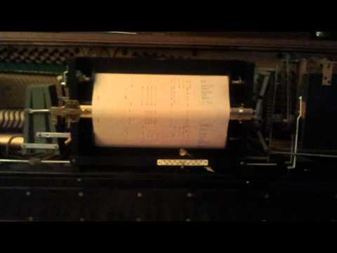 """Old Pianola playing """"Lady in red"""" from paper roll"""