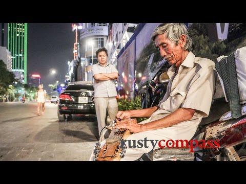 Hawaiian guitar's mournful sounds on a Saigon street