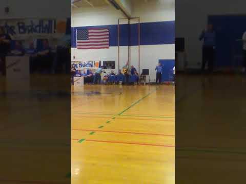 Gary Carpentir singing at Oswego middle school