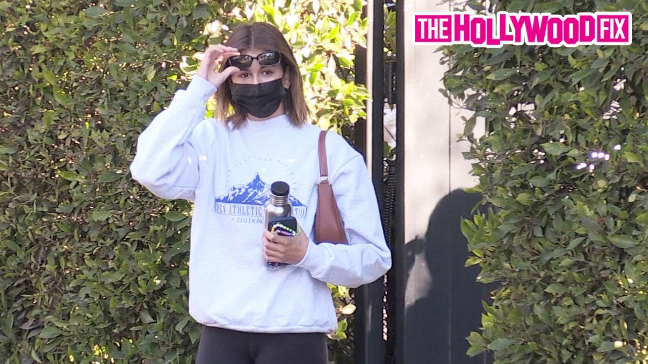 Kaia Gerber Keeps It Comfy In A Vintage Sweater & Leggings While Leaving A Private Gym Session