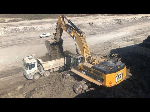 caterpillar-390d-excavator-loading-mercerdes-arocs-trucks---pyramis-ate