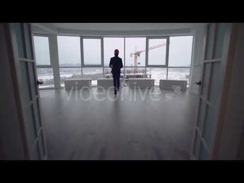 Building Engineer or Manager in Real Estate Company Enters the Room. | Stock Footage - Videohive