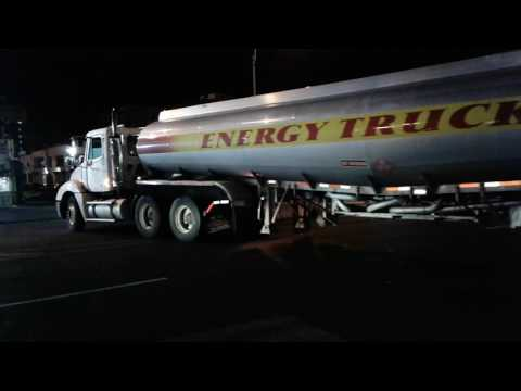 Tractor Trailer Gas Tanker back up into gas station