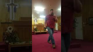 PASTOR Jody Harness preaching
