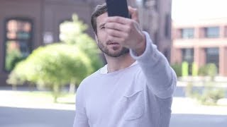 Handsome Man Taking Selfie on Phone | Stock Footage - Videohive