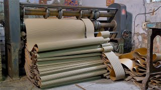 Wide shot of the machine cutting cardboard textured paper roll