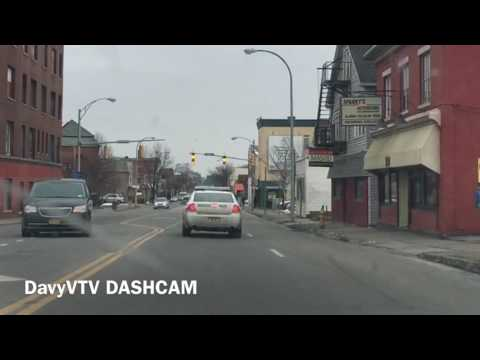 Distracted Rochester NY Cop Drives Reckless Crosses Double Yellow Lines Fails to Signal Lane Changes
