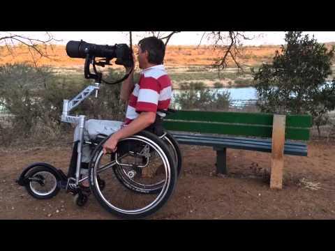 image Paraplegic woman climbing stairs