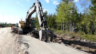 Volvo EC460BLC tearing up a road