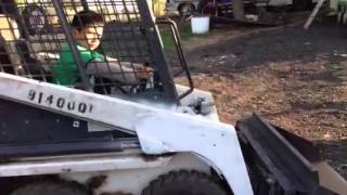 7 year old learning to drive a Bobcat