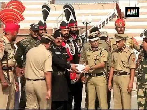 Indian army exchange sweets and gifts with Pakistan at Wagah Border