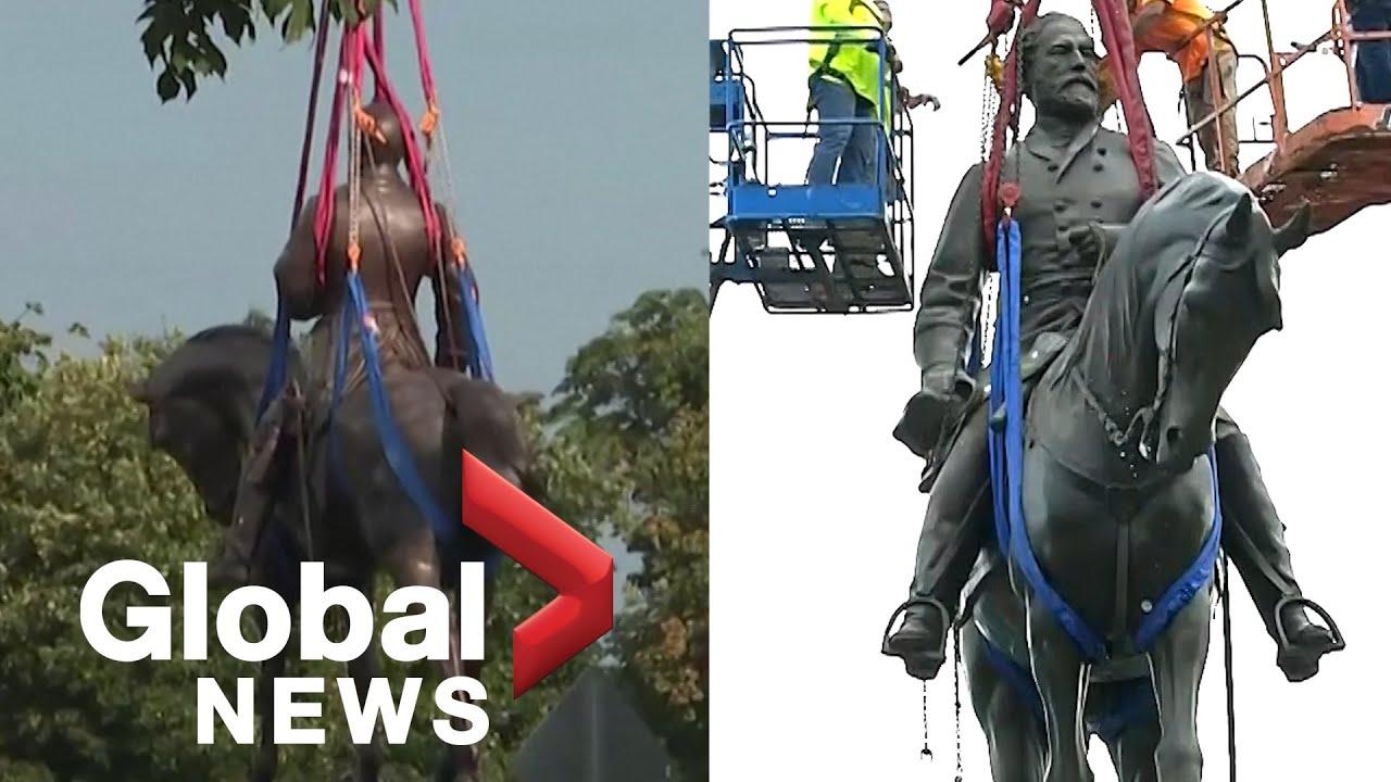 Richmond's massive Robert E. Lee statue removed from pedestal ...