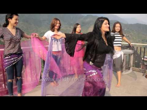 Tibetan beauty pageant contestants practice dance with instructor