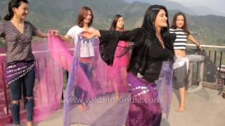 Repeat youtube video Tibetan beauty pageant contestants practice dance with instructor