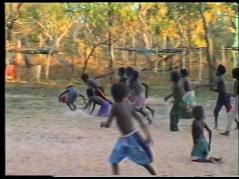 Aboriginal kids playing Aussie Rules football