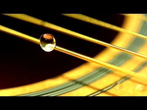 WATER DROPLET ON GUITAR STRING in Slow Motion (Super Close Up!) - Slow Mo Lab