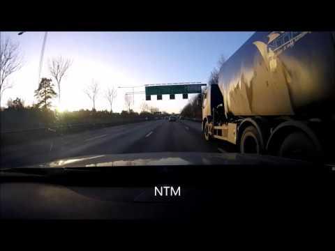 Truck dumping trash on highway - E4/E20 Stockholm