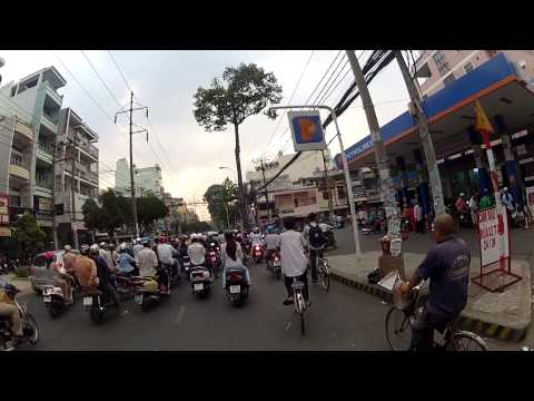 Scooter ride in Vietnam, Saigon (Ho chi minh city) in the afternoon
