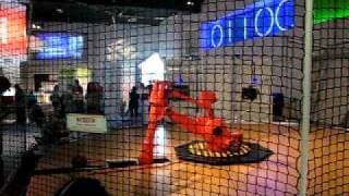Robot shoots a basketball