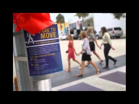 Fort Lauderdale Asks Pedestrians To Wave Bright Orange Flags When Crossing Busy Intersection