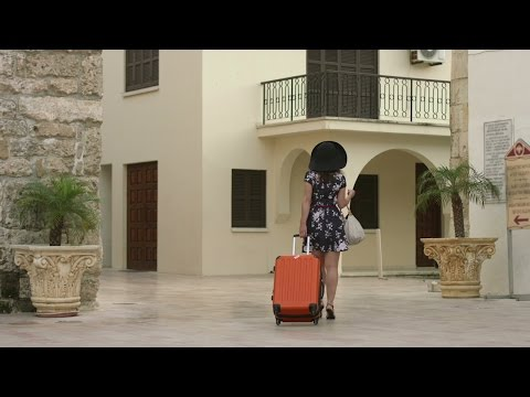Beautiful young female leaving for airport, vacation in exotic country abroad. Stock Footage