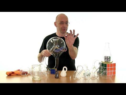 A mirror paradox, Klein bottles and Rubik's cubes