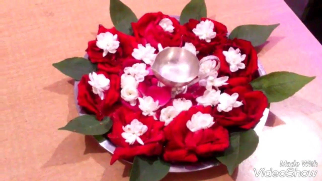 Decorative pooja thali ideas rose flower decoration thali for Aarti thali decoration with flowers