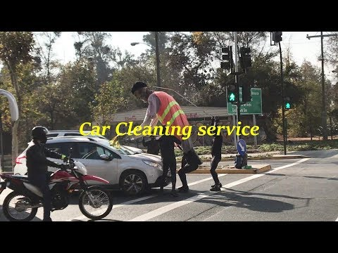Car cleaning service at traffic lights in Santiago, Chile
