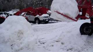 Building a snowman with a Mahindra Tractor video 2