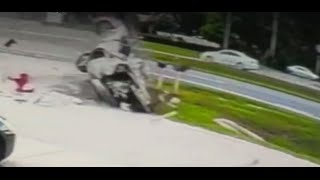 Dramatic Surveillance Video Shows Car Flipping More Than A Dozen Times