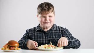 Young Fat Boy Eats Chocolate - (food) Stock Footage | Mega Pack +40 items