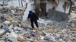 87-year-old woman with Coffin cries upon helpless debris house after developer
