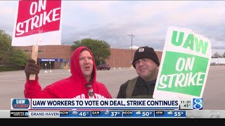 UAW workers to vote on deal, strike continues