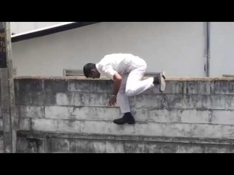 Kotte Ananda Sastralaya Boys jumping over school wall 1
